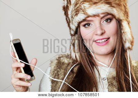 Winter Girl Listening Music.