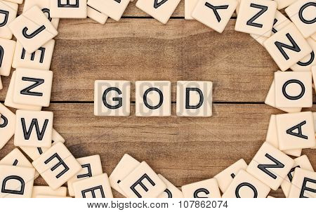 God Spelled Out In Tan Tile Letters