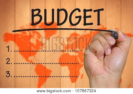 Hand Writing Budget Over Blur World Background