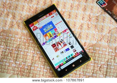 Zhongshan,china-nov 11, 2015:mobile Entering Taobao Online Shop On November 11 On The Bed With A Cre