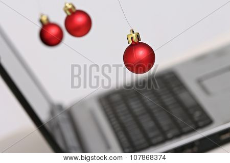 christmas balls and laptop computers