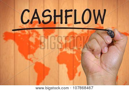 Hand Writing Cashflow  Over Blur World Background