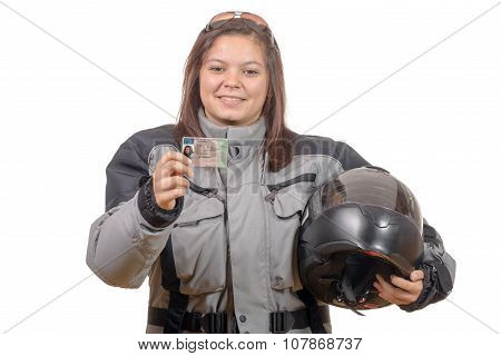 Happy young woman showing proudly her new motorcycle license