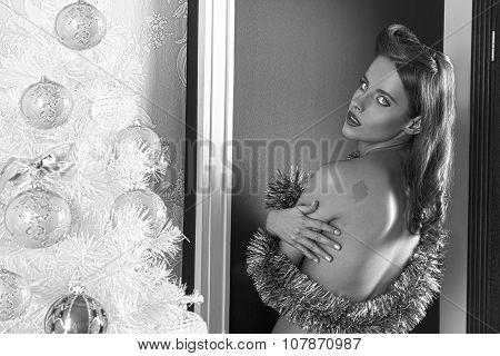 Charming Woman Near Christmas Tree . Desaturate Bw