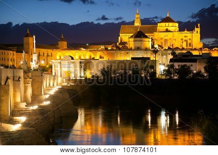 Famos Mosque (Mezquita) and Roman Bridge at night with illuminations, Cordoba, Andalusia, Spain, Europe