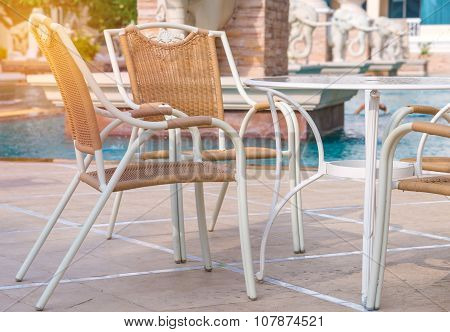 Chairs And Tables Next To Swimming Pool