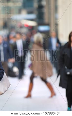 young woman walking in Canary Wharf blur. London