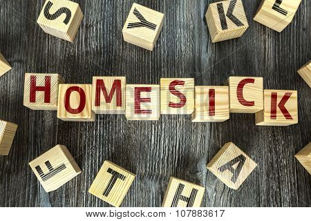 Wooden Blocks with the text: Homesick