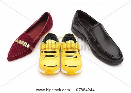 Shoes For Dad Mom And Son On A White Background