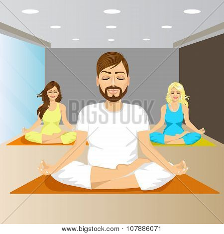 young people sitting in yoga pose on mat in gym