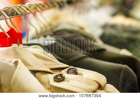 Male Coat With Bright Buttons Hangs On A Hanger In The Storeb
