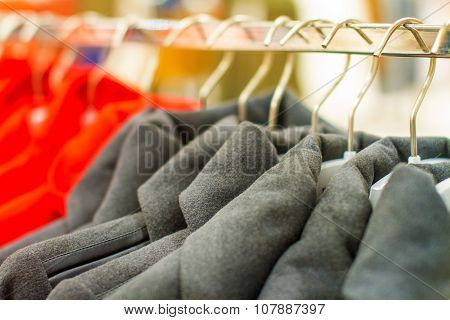 Female Black Coat With Buttons Hangs On A Hanger In The Store