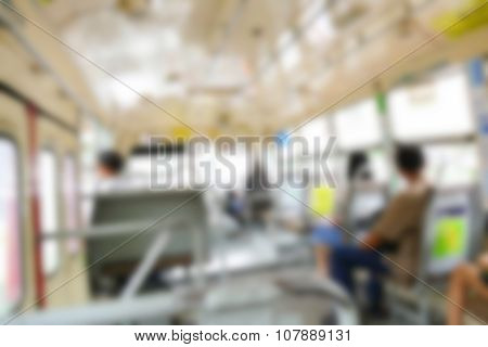 Blurry Defocused Image Of Asian People Sitting On The Public Bus
