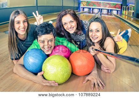 Best Friends Using Selfie Stick Taking Pic On Bowling Track - Yougn Friendship Playful Concept