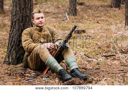 Young unidentified re-enactor dressed as Soviet soldier in over