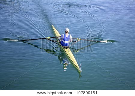 Young Man Rower In A Boat