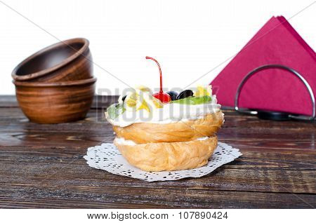Choux Pastry With Fruit On A White Background