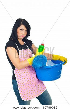 Miffed Woman Holding Cleaning Products