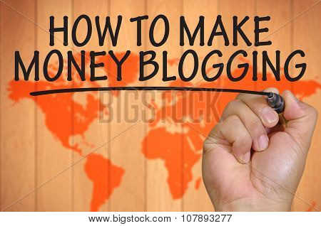 Hand Writing How To Make Money Blogging Over Blur World Background