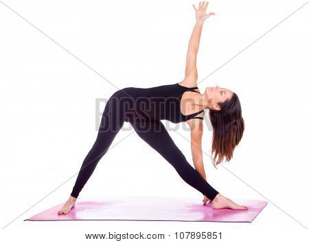 Beautiful woman doing Parivrtta Trikonasana  pose on yoga class, Studio shot.
