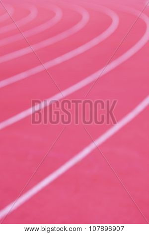 Abstract Blurred Background Of Closeup Red Running Racetrack.