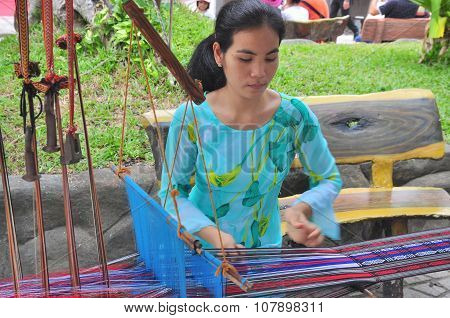 Nha Trang, Vietnam - July 11, 2015: A Girl Is Performing The Champa Textile Technique At The Po Naga