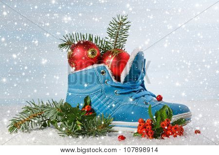 Blue shoe with Holly leaves and berries. Christmas background