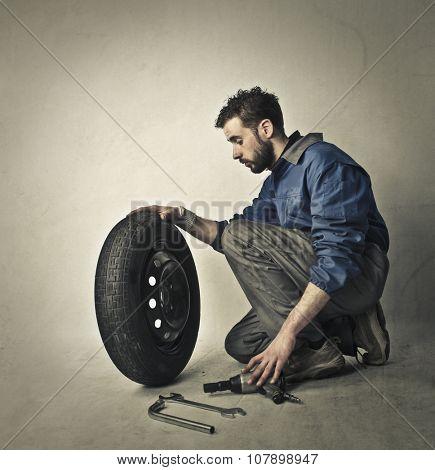 Mechanic fixing a cartwheel