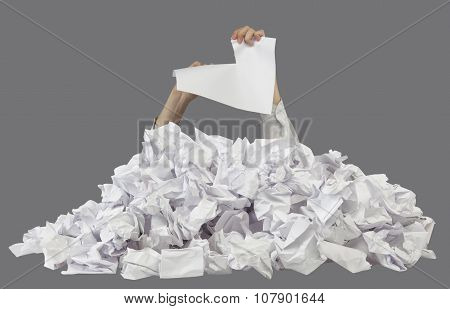 Hands With Lacerated Paper Reaches Out From Crumpled Papers