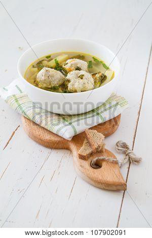 Sorrel soup in white bowl