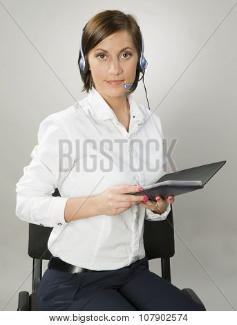 Young Woman With Headphones And Notebook