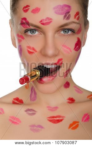 Beautiful Woman With Kisses On Face And Lipstick In Mouth