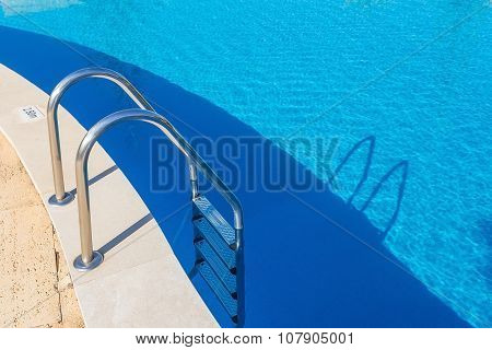 Entrance Steps In The Pool. Handrails Of Metal.