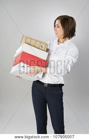Secretary Woman With A Large Stack Of Folders