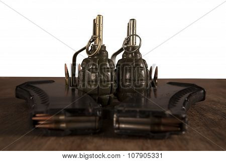 Hand Grenade And Ammunition On Table Isolated On White Background