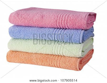 stack of colorful terry towels isolated on white background