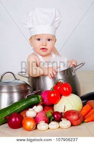 Baby cook in saucepan
