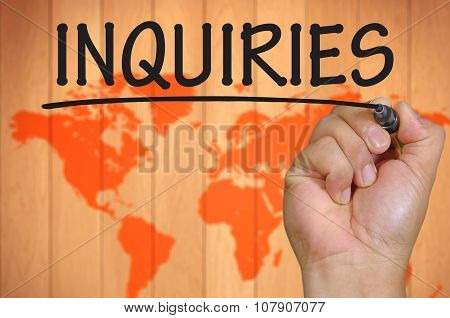 Hand Writing Inquiries Over Blur World Background