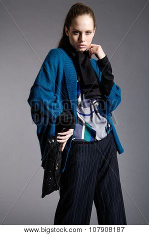 fashion model with scarf  posing-gray background