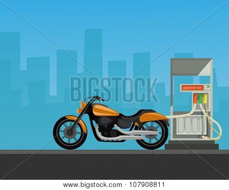 Gas station with motorcycle in city background.