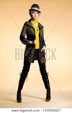Full body fashion model in fashion dress with hat posing
