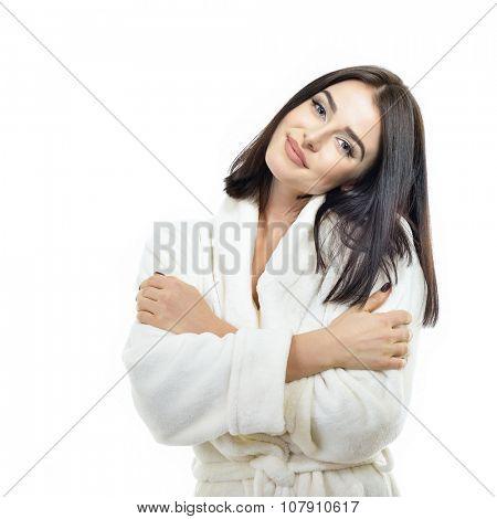 Portrait of beautiful woman in soft beige bathrobe