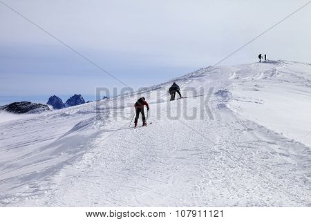 Skiers On Ski Slope At Wind Day