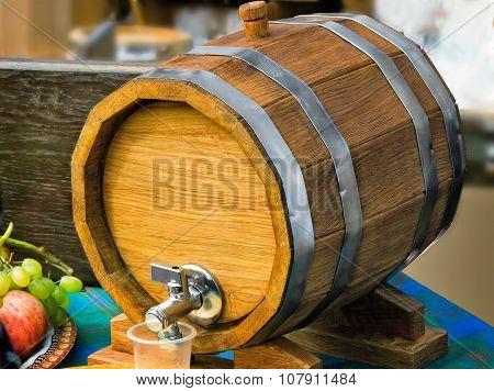 Wooden Oak Wine Barrel With Metal Tap.