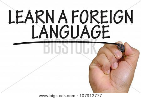 Hand Writing Learn A Foreign Language Over Plain White Background