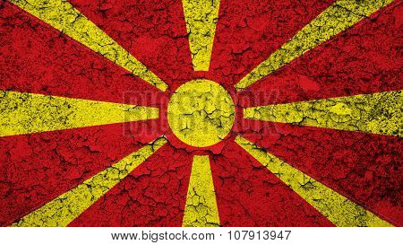 Flag of the Republic of Macedonia, Macedonian Flag painted on cracked paint.