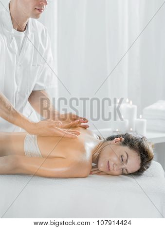 Woman Relaxing During Pleasant Massage