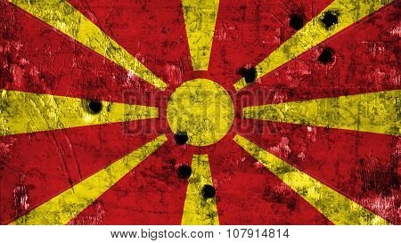 Flag of the Republic of Macedonia, Macedonian Flag painted on metal texture with bullet holes