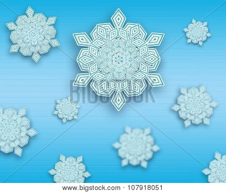 Blue beautiful paper cut snowflakes background.