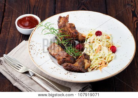 Grilled sliced barbecue pork ribs Salad cole slaw